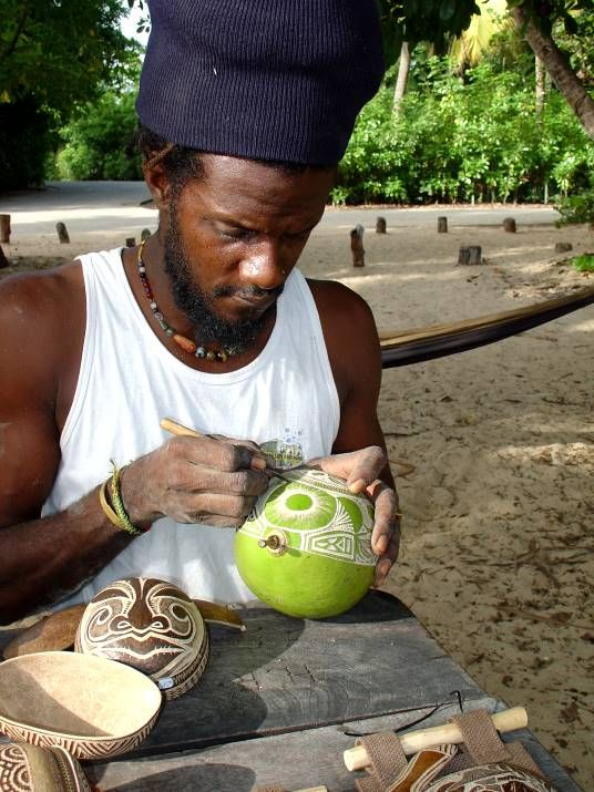 craftsman working a calabash at the beach
